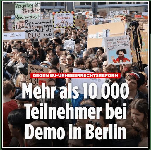 Screenshot Bild.de - Gegen EU-Urheberrechtsreforn - Mehr als 10000 Teilnehmer bei Demo in Berlin - mit einem Foto, das Demonstranten in Berlin zeigt, die beschriftete Schilder hochhalten