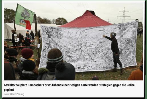 Screenshot Bild.de - Bildunterschrift - Gewaltschauplatz Hambacher Forst: Anhand einer riesigen Karte werden Strategien gegen die Polizei geplant