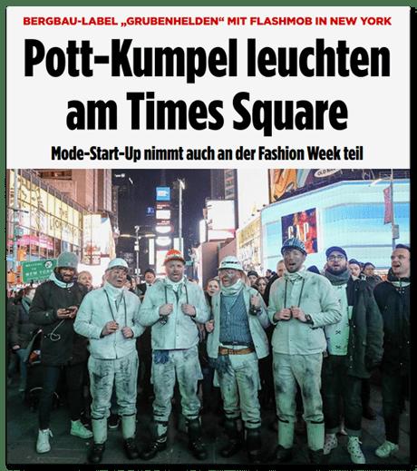 """Schlagzeile Bild.de: Bergbau-Label """"Grubenhelden"""" mit Flashmob aus New York - Pott-Kumpel leuchten am Times Square - Mode-Start-Up nimmt auch an der Fashion Week teil"""